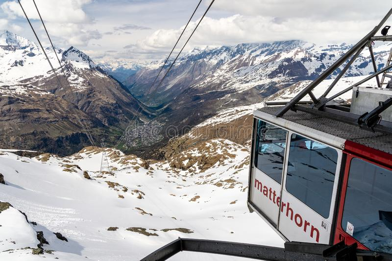 A majestic view of snow covered alps from matterhorn gondola cable car, zermatt switzerland royalty free stock images