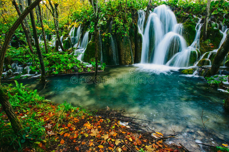 Majestic view on turquoise water and sunny beams in the Plitvice Lakes National Park. Croatia stock photography