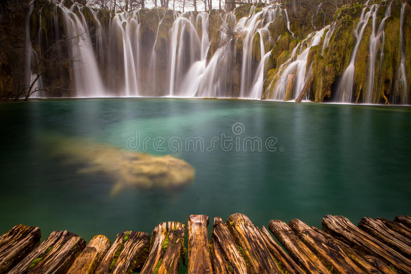 Majestic view on turquoise water and sunny beams in the Plitvice Lakes National Park. Croatia. Europe. Dramatic unusual scene. Bea royalty free stock photo