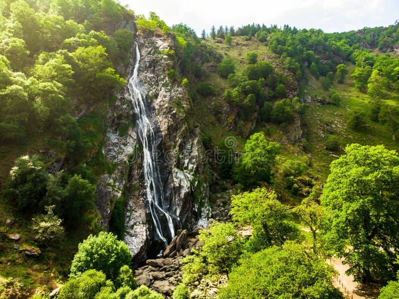 Majestic water cascade of Powerscourt Waterfall, the highest waterfall in Ireland. stock image