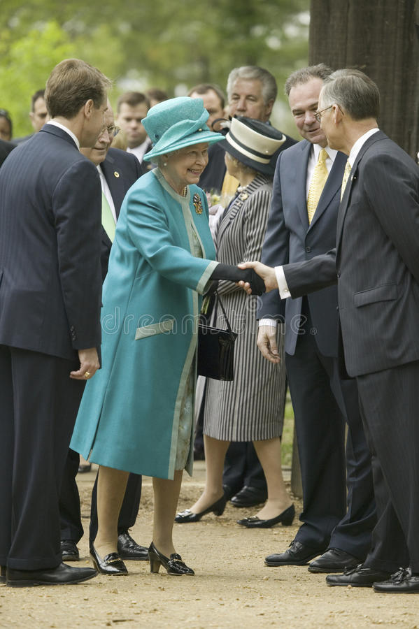 Majesty Queen Elizabeth II. Phil Emerson (left) and Her Majesty Queen Elizabeth II shaking hand of Senator Tommy Norment during her official visit James Fort royalty free stock photography