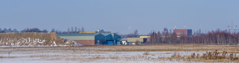 Majoppeveld een de industrieterrein van Roosendaal, Nederland, Nederlands industrieel landschap stock afbeeldingen