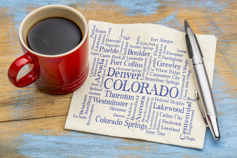 Major cities of Colorado word cloud on napkin. Major cities of Colorado with population more than 5000 word cloud - handwriting on a napkin with a cup of coffee royalty free stock photos