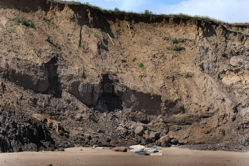 Major erosion of soft clay cliffs on the east coast of Yorkshire, UK. royalty free stock photography