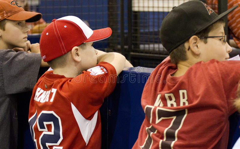 Major League Baseball All Star Game FanFest. Boys look over the fence to get a good look at Major League Baseball All Star Game's FanFest at the Phoenix royalty free stock images
