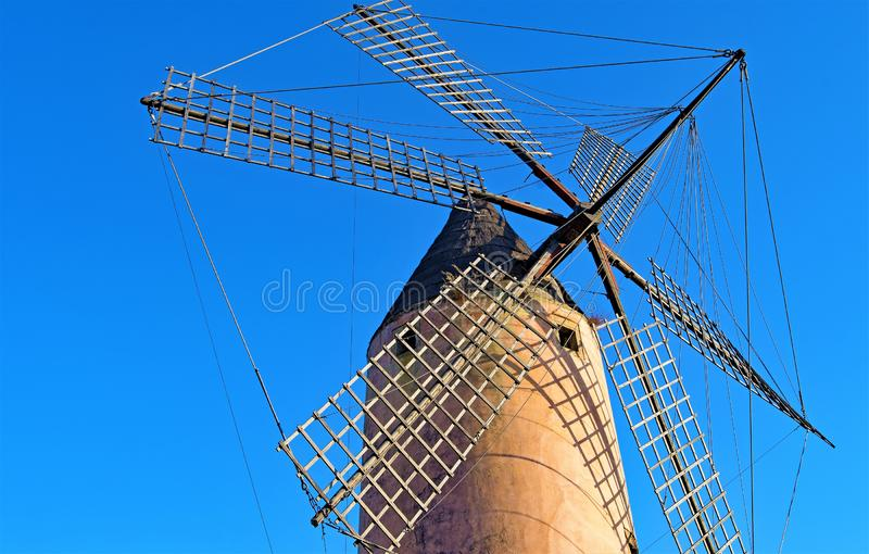 Majorca Windmill at dusk, in Santa Ponca, Majorca, Spain. A clear blue sky amd ambient lighting at dusk, helped to capture this well preserved traditional royalty free stock photos
