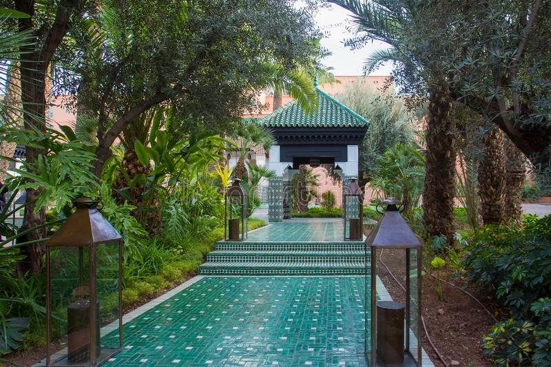 Beautiful garden  and  alcove  in  Morocco. Marrakech. Decorated  famous  moroccan tiles royalty free stock photos