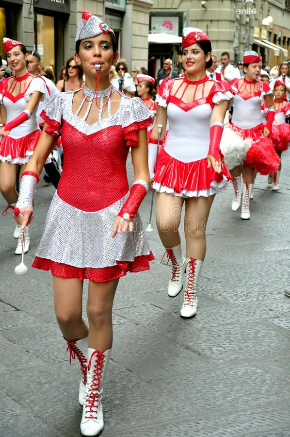Majorette, cheerleader in Italy. A majorette is a person doing choreographed dance or movement, primarily baton twirling associated with marching bands during stock photos