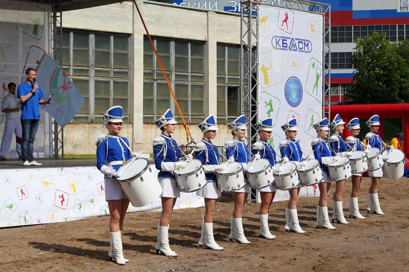 Majorettes. Show-group of drummers in blue uniform of the Royal lancers. Show-group of drummers Malaya Okhta is a group with powerful energy, gorgeous costumes royalty free stock images