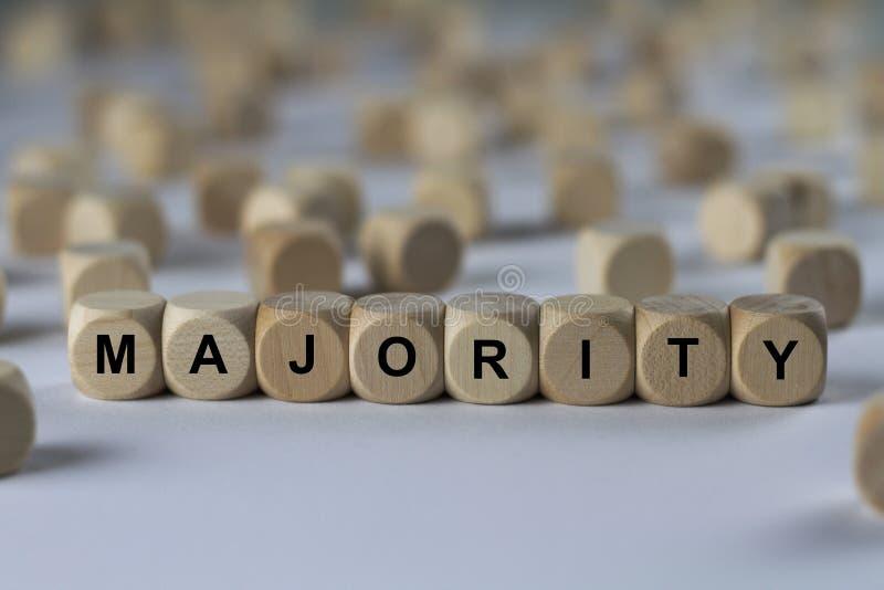 Majoritet - kub med bokstäver, tecken med träkuber royaltyfria bilder
