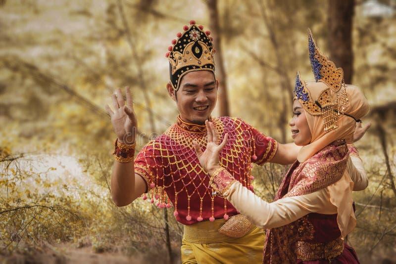 Mak Yong Dance. Kampung Mek Mas, Kota Bahru, Kelantan / Malaysia - July 15, 2017 : A shot of two person in traditional clothing performing a dance called `Mak royalty free stock photography