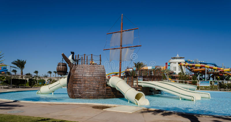 Water park, Makadi Water World, Hurghad. Madinat Makadi – January 2016: Water park, the hills for the children in the in the shape of a pirate ship royalty free stock image