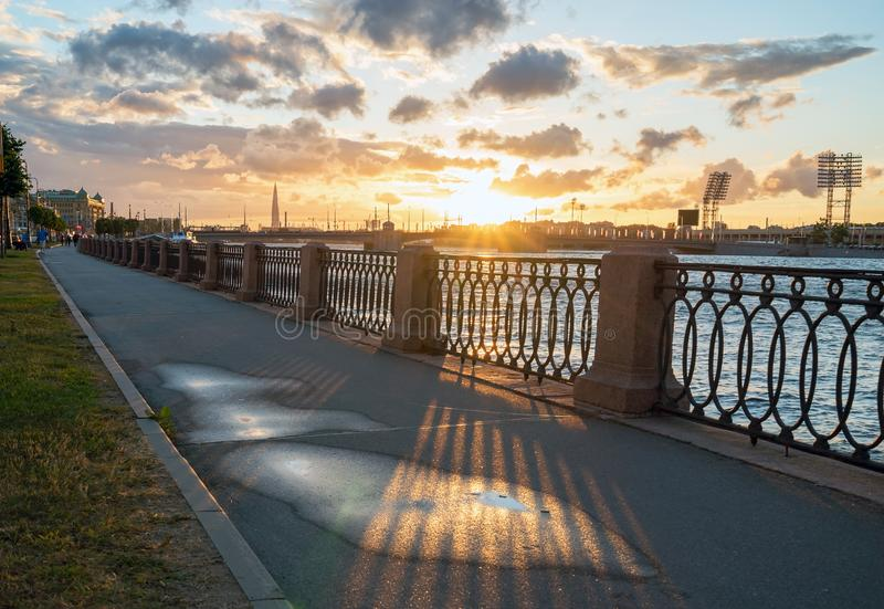Makarova embankment, in the evening at sunset in the direction of Petrovsky stadium . Saint-Petersburg. Russia stock image