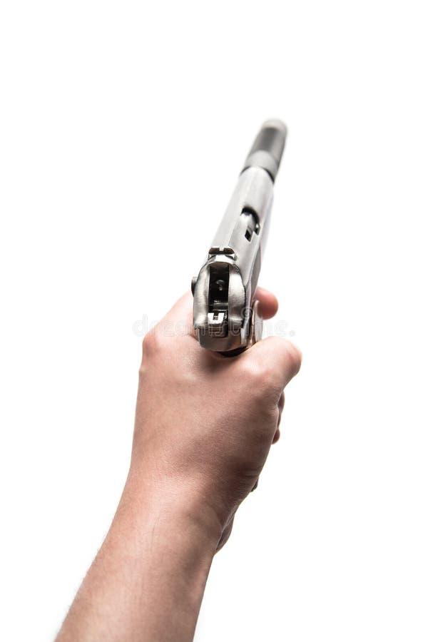 Makarow-Pistole mit Schalldämpfer in der Hand zielen lizenzfreie stockbilder