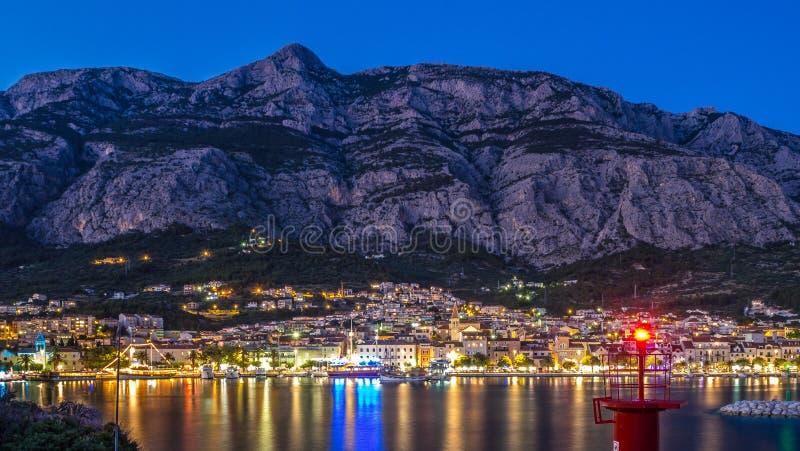 Makarska and Biokovo moutain at night stock images