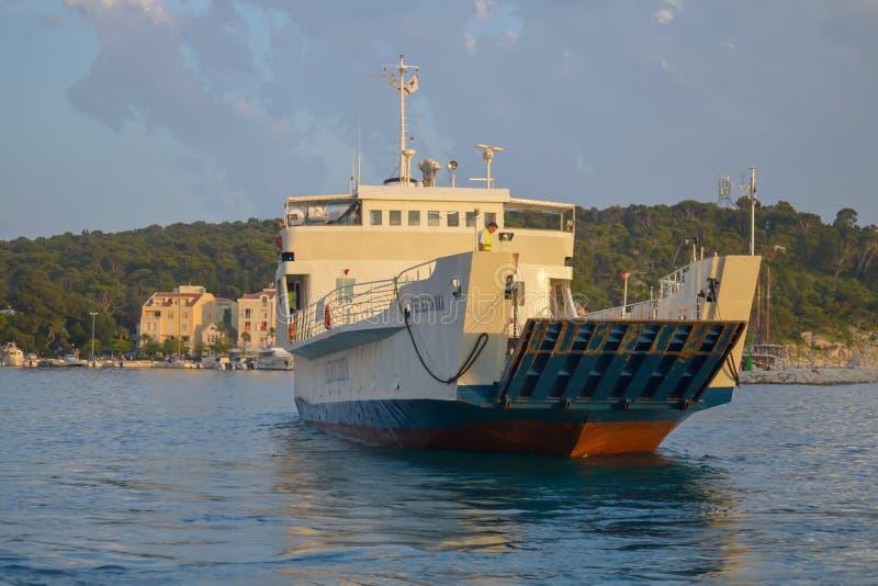 Ferry to Brac island leaving fisherman`s Wharf of Makarska city in Makarska, Dalmatia, Croatia on Jun stock photography