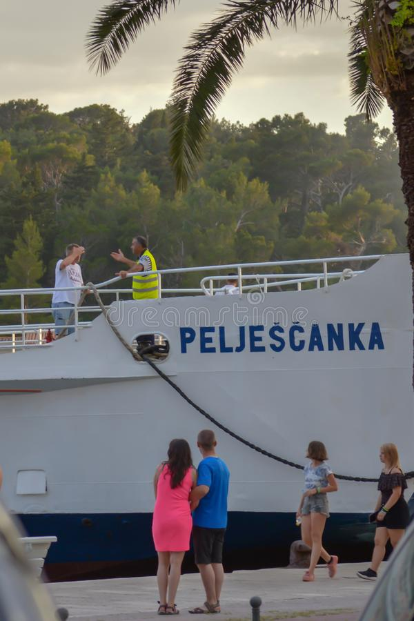 Ferry to Brac island leaving fisherman`s Wharf of Makarska city in Makarska, Dalmatia, Croatia on Jun royalty free stock image