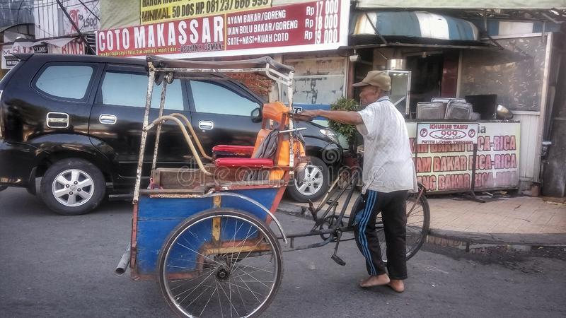 Makassar, Indonesia. August 4, 2019: Pedicab, one of the traditional transportation in Indonesia. Especially in Makassar City. Pedicap are very popular with stock photography