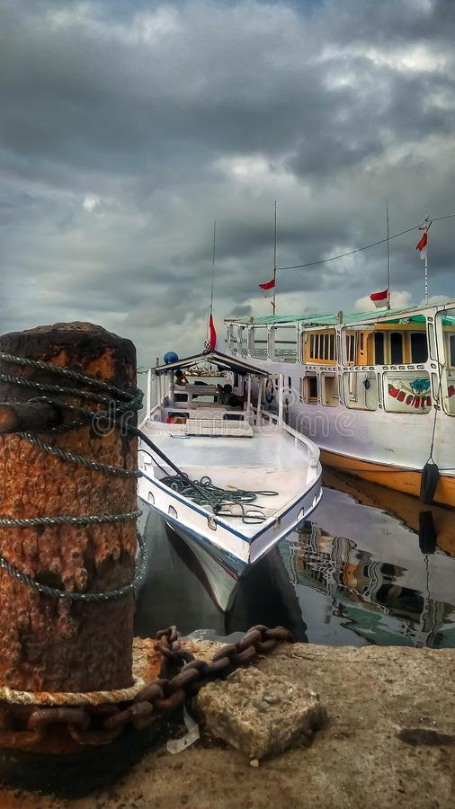 Makassar, Sulawesi, Indonesia. December 11, 2018: Lives of fishermen on fishing vessels. Their ship was leaning on the harbor. Makassar, South Sulawesi stock photos