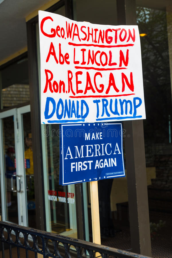 Make America First Again Sign at Trump Rally. Lancaster, PA - August 9, 2016: Signs at a rally during GOP Vice Presidential candidate Gov. Mike Pence appearance royalty free stock photos