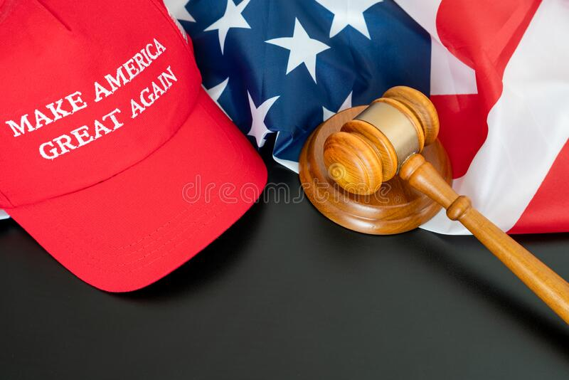 Make america great again text on red cap with the american national flag and judge gavel and striking block. On black background with copy space. Politics  and royalty free stock photo