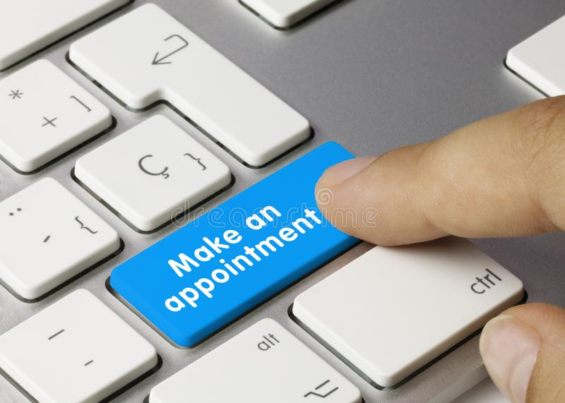Make an appointment - Inscription on Blue Keyboard Key. royalty free stock photos