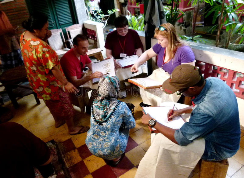 Make batik cloth. Tourists are learning to make batik cloth at art gallery in the city of Solo, Central Java, Indonesia royalty free stock photography