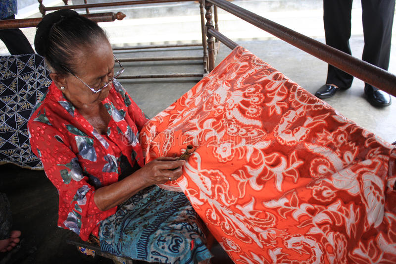 Make batik. A old ladies make batik on cloth with canting in Solo royalty free stock image