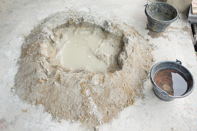 Make concrete pile with bucket full water stock photo