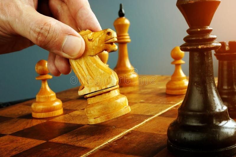 Make decisions and challenge. Chess player makes a move. Make decisions and challenge concept. Chess player makes a move royalty free stock photography