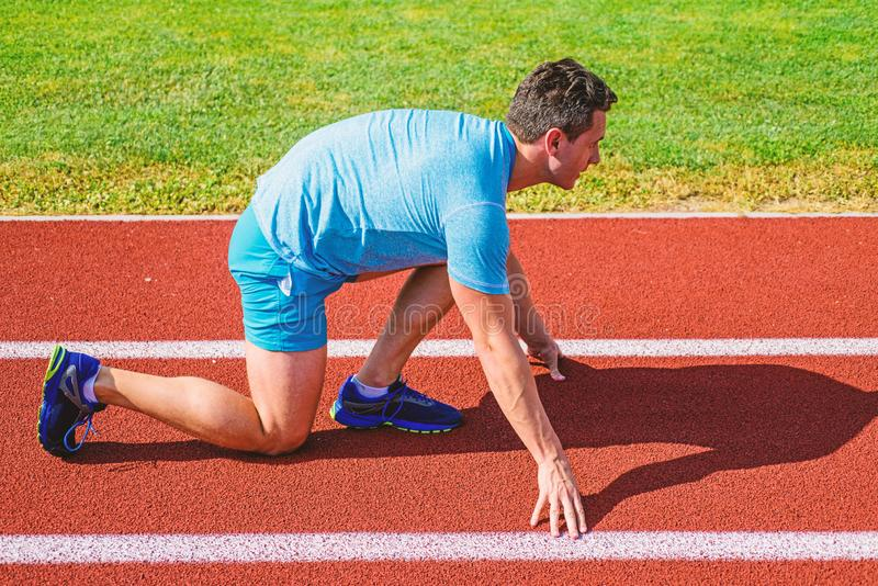 Make effort for victory. Runner ready to go. Adult runner prepare race at stadium. How to start running. Sport tips from. Professional runner. Man athlete royalty free stock images