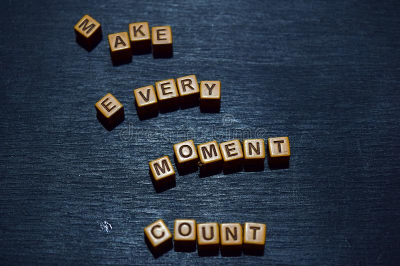 Make every moment count message written on wooden blocks. Motivation concepts. Cross processed image stock image
