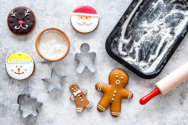 Make gingerbread cookies for new year 2018. Sweets near baking sheet and rolling pin on grey background top view royalty free stock photo