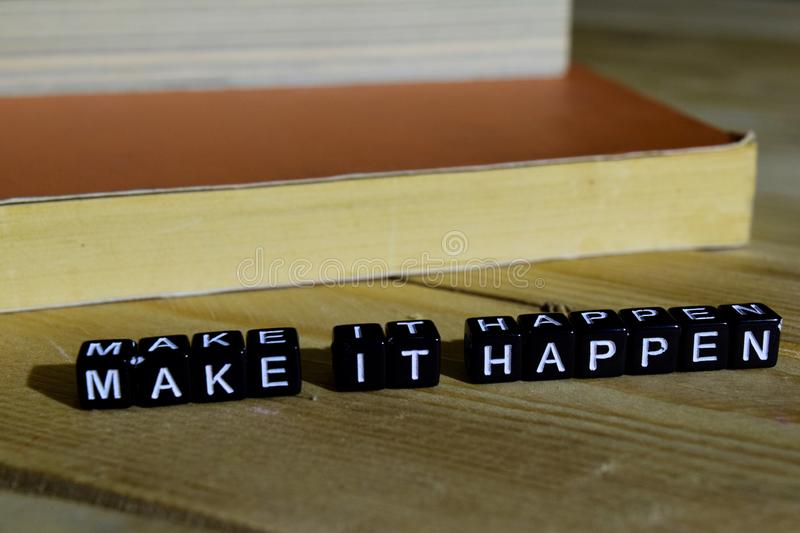 Make it happen on wooden blocks. Motivation and inspiration concept royalty free stock image