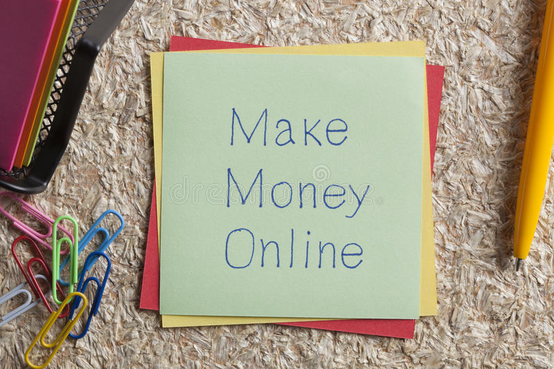 Make Money Online written on a note. Top view of Make Money Online written note on the wood chippings board stock photo