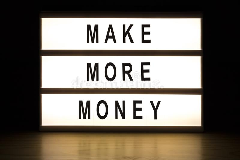 Make more money light box sign board stock photography