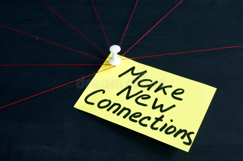 Make new connections written on page. Work in business team royalty free stock images