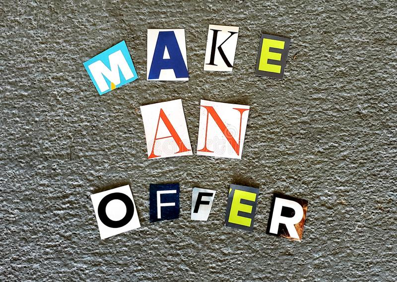 Make An Offer. Colorful letters that encourage people to make an offer stock photo