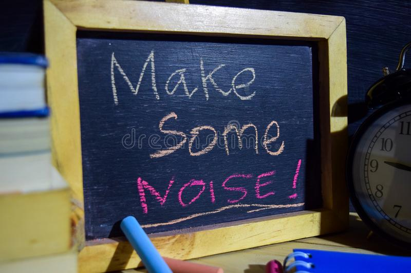 Make some noise! on phrase colorful handwritten on blackboard. royalty free stock image