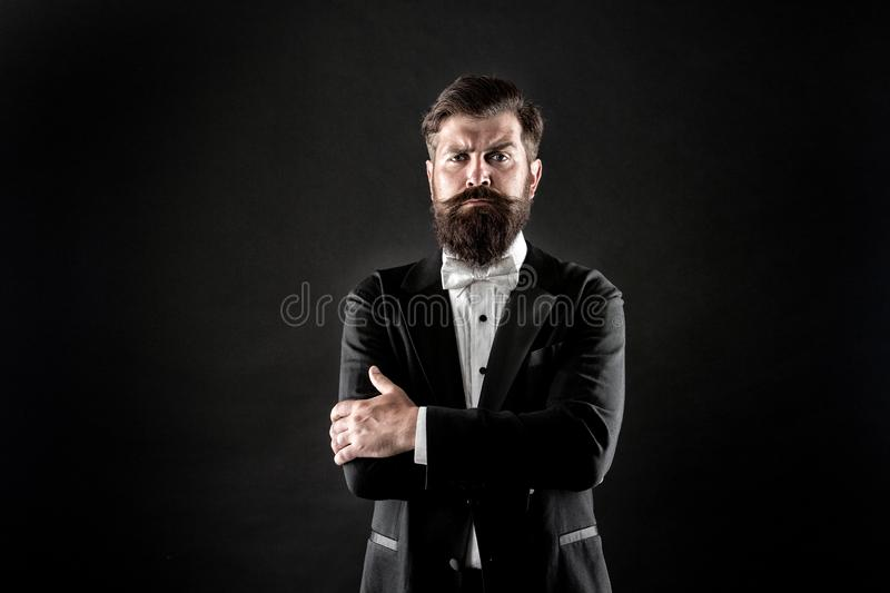 Make statement. Confident man black background. Bearded man keep arms crossed with confidence. Confident look of fashion royalty free stock images