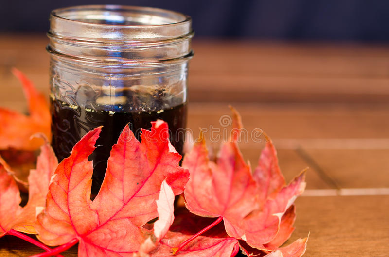 Maple Syrup and Maple Leafs royalty free stock photo