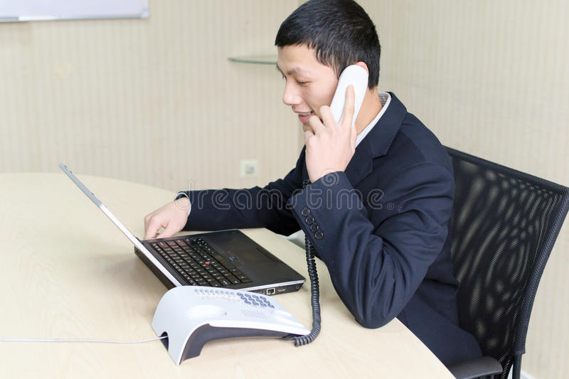 Make a telephone call. Young business is making a telephone call stock image