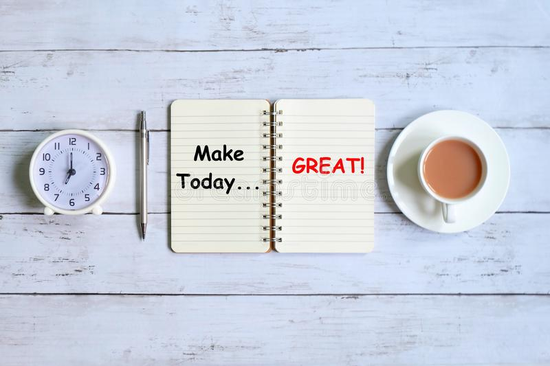Make today great written on notebook stock photos
