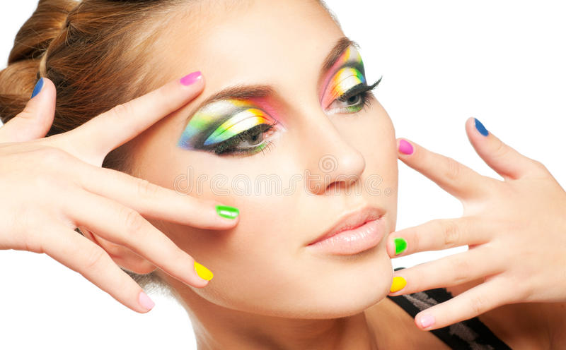 Make-up. Woman face with rainbow makeup stock images