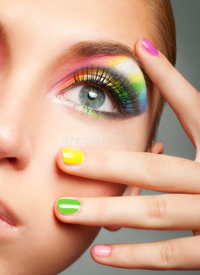 Make-up. Woman face with bright rainbow makeup stock photos