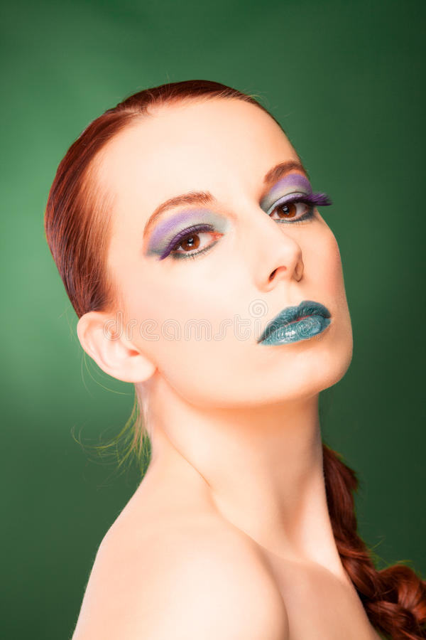Make up. Atractive young red-hair woman with extrem make up royalty free stock image