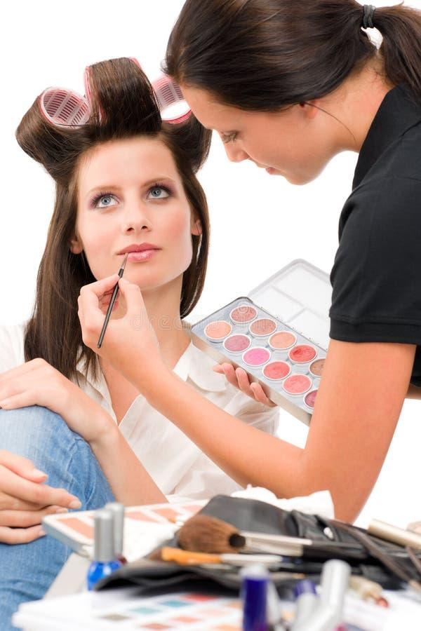 Make-up artist woman fashion model apply lipstick