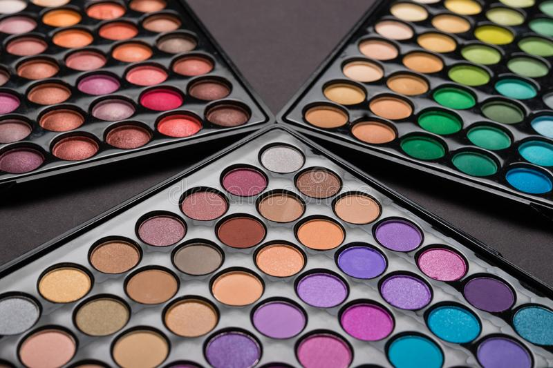 Makeaup background of colorful eyeshadow palettes royalty free stock photography