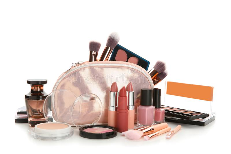 Make-up bag and set of decorative cosmetics on white background stock photography