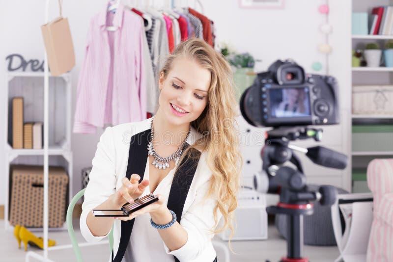 Make up blogger. Holding eye shadow palette stock images